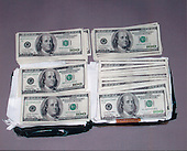 "Washington, DC - February 20, 2001 -- Package recovered at the ""Lewis"" drop site on Vienna, Virginia containing $50,000 cash left by Russians for Hanssen..Credit: FBI via CNP"
