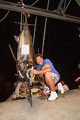Bomboy Lure held by Bomboy LLanes and the Pacific Blue Marlin Grander caught on it.