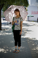 Muji'er, unemployed, age 22, poses for a portrait in Beijing. Response to 'What does China mean to you?': '[no answer]'  Response to 'What is China's role in the future?': 'Very good development.'