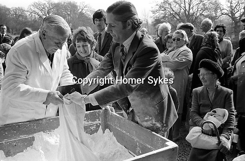 The Tichborne Dole. Tichborne, Hampshire 1974. The annual dole of flour, is first blessed on the steps of the house by the family priest on Lady Day, 25 March, and then distributed by Mr Jonkheer John Loudon and a family retainer.