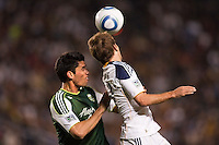 Portland Timbers defender Steve Purdy (25) and Mike Magee (18) of LA Galaxy battle. The LA Galaxy defeated the Portland Timbers 3-0 at Home Depot Center stadium in Carson, California on  April  23, 2011....