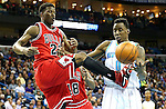 Feb 19, 2013; New Orleans, LA, USA; New Orleans Hornets forward Al-Farouq Aminu (0) reaches for the ball beside Chicago Bulls guard Jimmy Butler (21) during the second quarter at the New Orleans Arena. Mandatory Credit: Crystal LoGiudice-USA TODAY Sports