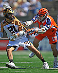 23 August 2008: Rochester Rattlers' Midfielder Brett Bucktooth (21) is checked by Philadelphia Barrage David Schecter (17) during the Semi-Finals of the Major League Lacrosse Championship Weekend at Harvard Stadium in Boston, MA. The Rattlers defeated the Barrage 16-15 in sudden death overtime, advancing to the upcoming Championship Game...Mandatory Photo Credit: Ed Wolfstein Photo