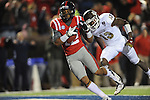 Ole Miss wide receiver Donte Moncrief (12) makes a 16 yard touchdown reception behind Mississippi State defensive back Johnthan Banks (13) at Vaught-Hemingway Stadium in Oxford, Miss. on Saturday, November 24, 2012. Ole Miss won 41-24. Moncrief had 7 catches for 173 yards and 3 touchdowns.
