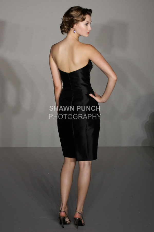 Model walks runway in a Black Mikado sheath dress, Black lace panel over Mink lining bridesmaid outfit by Fracesca Pitera for the Jim Hjelm Spring 2012 collection, at the JLM Couture fashion show, during Bridal Week New York Spring 2012.