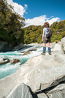 Young female, woman, tramper enjoying scenic and wild Perth River, South Westland, West Coast, South Westland, New Zealand