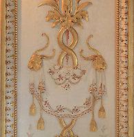 """Detail of a painted decorative wall panel with gilded carved stuccoes depicting lions' heads, Turkish Boudoir, redesigned in 1777 for Marie Antoinette, by architect Richard Mique, Chateau de Fontainebleau, France. The decoration is the achievement of the brothers Rousseau, and the furniture dates to the period of the First Empire, with precious textile work done by Jacob-Desmalter for Empress Josephine. Including a small bedroom, mirrors, and curtains raised by pulleys, this exceptional ensemble has been restored in 2014 thanks to the support of INSEAD and the generosity of subscribers of sponsors belonging to the group """"Des Mécènes pour Fontainebleau"""". Its opening to the public is schedule for Spring 2015. Picture by Manuel Cohen"""