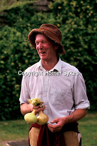 'ENGLISH VILLAGE FETE', MARTIN SQUIRES, A LOCAL FARMER WITH HIS BEST ONIONS SELECTED FOR THE COMPETITION.,