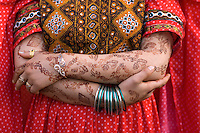 Hennaed hands and arms of women in Bagh-E-Zanana Park-Women's Park.