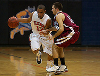 November 16, 2010 - Salem, MA - Apollos Wade, guarded by Kyle Nadeau of the WPI Engineers dribbles the ball up court for the Salem State Vikings. The Engineers defeated the Vikings 78-62 in the season opener. (Photo by Matt Wright)