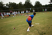 Nick Acosta, of Balls Deep, pitches to a member of 2 Legit 2 Kick during a kick ball match at Pullen Park in Raleigh, Tuesday, Aug. 12, 2008.