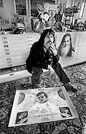 New York City, USA. April 1969. American artist Peter Max at home in New York City in 1969 with some examples of his work. Max combined the techniques of neo expressionism and vibrant use of color to depict contemporary American culture.
