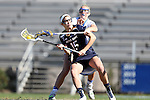 DURHAM, NC - FEBRUARY 26: Notre Dame's Cortney Fortunato (15) is tied up by Duke's Devon Russell (behind). The Duke University Blue Devils hosted the University of Notre Dame Fighting Irish on February, 26, 2017, at Koskinen Stadium in Durham, NC in a Division I College Women's Lacrosse match. Notre Dame won the game 12-11.