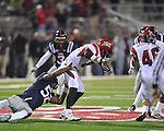 Ole Miss linebacker Mike Marry (52) tackles Louisiana-Lafayette's Brad McGuire (8)   in Oxford, Miss. on Saturday, November 6, 2010. Ole Miss won 43-21.