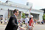 MAY 30, 2011 - LITTLE NECK, NY: New York Governor Andrew M. Cuomo marching in Little Neck-Douglaston Memorial Day Parade in front of U. S. Post Office Little Neck Station Flushing NY, on Northern Boulevard on May 30, 2011.