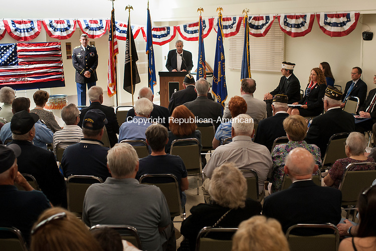 SOUTHBURY, CT-8 May 2015-050815EC02-  Southbury First Selectman Ed Edelson makes remarks Friday at the Southbury Senior Center during the unveiling of a Veteran Wall of Honor. The wall is in the lounge of the senior center. Erin Covey Republican-American