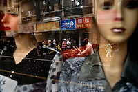 Mannequins display clothing for sale in a window display in the Bund area of Shanghai, China.