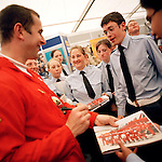 Pilot of the 'Red Arrows', Britain's Royal Air Force aerobatic team signs literature for junior RAF cadets. .