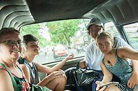 in the back of a Bemo.<br /> Denpasar, Bali