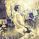 Man meditating in the forest.