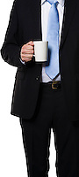 Executive holding a mug to show its time for a little break