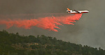 Bear Valley--July 26, 2008--Telegraph Fire, near Yosemite National Park.DC 10 tanker drop retardant on Mt. Bullion Ridge to protect Cell phone towers.  Image taken from Highway 49. Between Mt. Bullion and Bear Valley ..Photo by Al GOLUB/Golub Photography.