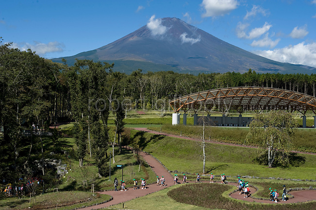 Kindergarten children walk across the broad lawns behind Jukuu no Mori - an educational facility teaching about the history of Mt. Fuji -- in Gotemba Shizuoka Prefecture Japan on 01 Oct 2012.  Photographer: Robert Gilhooly