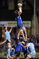 Stuart Hooper rises high to win lineout ball. Aviva Premiership match, between Bath Rugby and Northampton Saints on September 14, 2012 at the Recreation Ground in Bath, England. Photo by: Patrick Khachfe / Onside Images