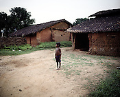 A young boy is seen outside his hut in Ijurupa village in Lanjigarh, Orissa, India