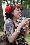 The Chap Olympiad Bedford Square London UK. Girl with self portrait tattoo.