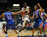 Ole Miss' Terrance Henry (1) vs. SMU's London Giles (11) and SMU's Cannen Cunningham (15) at the C.M. &quot;Tad&quot; Smith Coliseum in Oxford, Miss. on Tuesday, January 3, 2012. Ole Miss won 50-48.