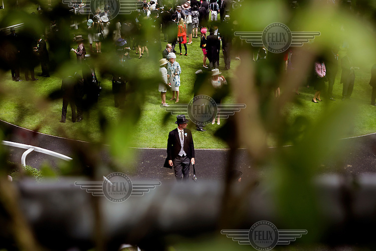 The parade ring during the Royal Ascot race meeting. The annual event, during which each day begins with the Queen's arrival in a horse drawn carriage, dates back to 1711 when Queen Anne organised the first races on what was then a heath near Windsor Castle.
