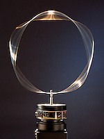 STANDING WAVE ON CIRCULAR HOOP<br /> (Variations Available)<br /> Analog - de Broglie Wavelengths &amp; Bohr Orbits<br /> A circular hoop of wire is vibrated at a variable frequency. At a frequency of 74 Hz the standing wave is visible on the wire- analagous  to the de Broglie formula for the electron orbital and showing the wave-particle duality of matter.