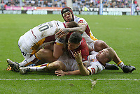 Wigan Warriors' Anthony Gelling stopped just short of the try line by Huddersfield Giants' Alex Mellor, Huddersfield Giants' Sam Rapira and Ryan Hinchcliffe <br /> Photographer Stephen White/CameraSport<br /> <br /> Betfred Super League Round 5 - Wigan Warriors v Huddersfield Giants - Sunday 19th March 2017 - DW Stadium - Wigan<br /> <br /> World Copyright &copy; 2017 CameraSport. All rights reserved. 43 Linden Ave. Countesthorpe. Leicester. England. LE8 5PG - Tel: +44 (0) 116 277 4147 - admin@camerasport.com - www.camerasport.com