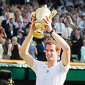 07.07.2013. The Wimbledon Tennis Championships 2013 held at The All England Lawn Tennis and Croquet Club, London, England, UK. Mens singles final.   Murray shows the winners trophy to the crowd. Andy Murray  (GBR) [2] defeated Novak Djokovic  (SRB) [1]  on Centre Court.