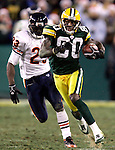 Green Bay's Donald Driver breaks away on a 56-yard pass reception from Brett Favre late in the 4th quarter to the Chicago 35-yard line. .The Green Bay Packers hosted the Chicago Bears at Lambeau Field Sunday December, 25, 2005. Steve Apps-state Journal.