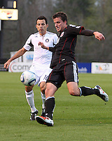 Mark Burch#4 of D.C. United boots the ball away from Marco Pappa#16 of the Chicago Fire during a second round match of the Carolina Challenge on March 9 2011 at Blackbaud Stadium, in Charleston, South Carolina. D.C. United won 1-0.