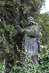 """A statue of Jesus  in  Vysehrad Cemetery in Vysehrad or the """"Castle on the heights,"""" an area of Prague that includes a large fortress and park, Czech Republic, Europe"""