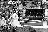 """Washington, D.C. - June 12, 1971 -- Tricia Nixon Cox and her husband, Edward Cox, walk down the aisle of the Rose Garden of the White House in Washington, D.C. on Saturday, June 12, 1971.  More than 400 guests attended the dazzling affair that was almost marred by rainfall..Credit: Benjamin E. """"Gene"""" Forte / CNP"""