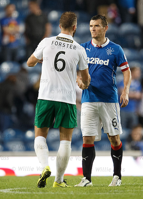 Jordan Forster and Lee McCulloch shake then appear to have a frank exchange of words after the final whistle