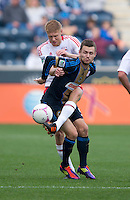 Markus Holgersson (5) of the New York Red Bulls fights for the ball with Jack McInerney (9) of the Philadelphia Union during the game at PPL Park in Chester, PA.  New York defeated Philadelphia, 3-0.