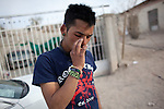Manny smokes marijuana outside his home in Ciudad Juarez, Mexico.