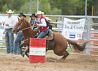 Senior Animal Science major Marissa Wallace, competes with her horse Miley in the barrel racing portion of Falcon Frontier Days Rodeo at Campus Farm Saturday, September 14, 2013. <br /> Kathy M Helgeson/UWRF Communications