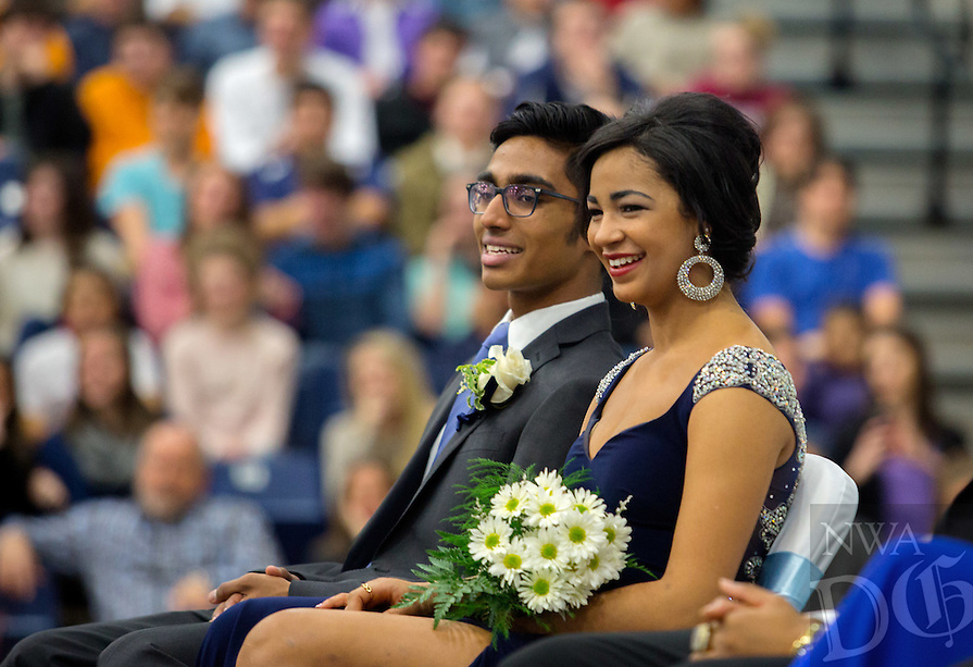 NWA Democrat-Gazette/JASON IVESTER --01/29/2015--<br /> Springdale Har-Ber senior maid Bre Cassenelli and her escort, Noah Antony, watch and listen as the Lighthouse Choir performs on Friday, Jan. 30, 2015, during the school's Winter Homecoming ceremony. See more photos at nwadg.com/photos.