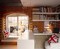 A partition creates storage and a cosy office space in this corner of an urban loft