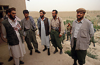 General Mohammad Quasim Fahim (on the right) with is commanders and soldiers in is Kichim office, at the frontline against the Taleban force in Konduz. Fahim was the right hand of warlord Ahmad Shah Massoud