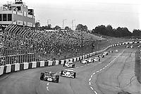 HAMPTON, GA - APRIL 22: Danny Ongais (#25 Parnelli VPJ6C/Cosworth TC) leads Tom Sneva (#1 McLaren M24/Cosworth TC) and others during the Gould Twin Dixie 125 event on April 22, 1979, at Atlanta International Raceway near Hampton, Georgia.