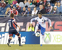 Montreal Impact substitute Andrea Pisanu collects a pass.  In a Major League Soccer (MLS) match, Montreal Impact (white/blue) defeated the New England Revolution (dark blue), 4-2, at Gillette Stadium on September 8, 2013.