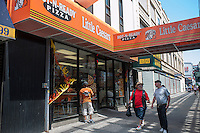 Little Caesars Pizza on Flushing Avenue in the Graham Avenue CBD in the Bushwick neighborhood of Brooklyn in New York on Sunday, June 2, 2013. As more and more hipsters move into the neighborhood the ethnicity of the area is changing.   (© Richard B. Levine)
