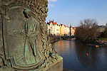 View of Prague's Old Town (Stare Mesto) in distance and sculpted figure of a man on Legion's Bridge, Prague, Czech Republic, Europe